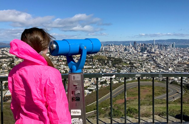 Natalie Bourn Using a Telescope at the Twin Peaks Overlook