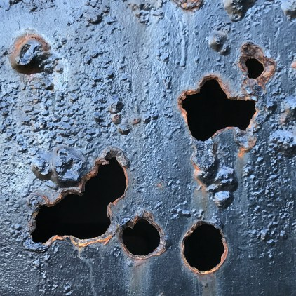 Rusted Holes in Metal Doors