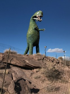 A Dinosaur Eating A Human At The Painted Desert Indian Center in Arizona