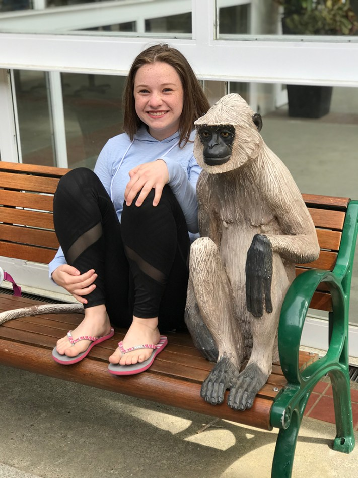 Natalie Posing With a Monkey Statue