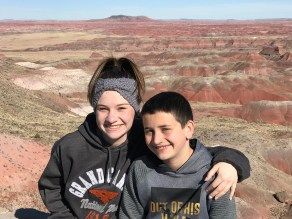 Natalie and Carter Bourn at Kachina Point Scenic Overlook in Petrified Forest National Park