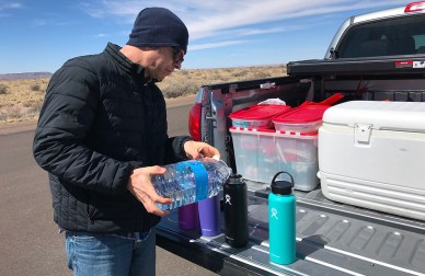 Refilling Our Hydroflasks With Water