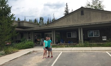 Natalie and Carter Bourn standing outside the Kawuneeche Visitor Center