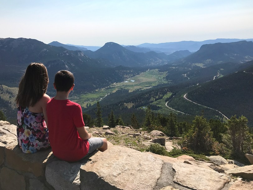 Natalie and Carter Bourn Relaxing at Rainbow Curve Overlook in Rocky Mountain National Park