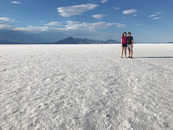 Natalie and Carter standing on the Bonneville Salt Flats