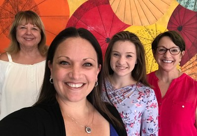 Bourn & Brannan Family selfie in from of an Umbrella Mural at the Japan Center Mall