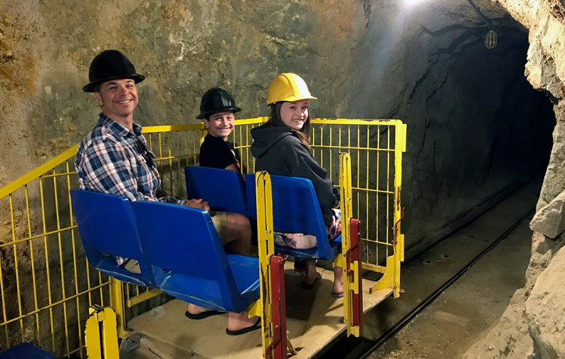 Brian, Carter, and Natalie Bourn Riding an Underground Tram Air Locomotive