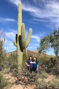 Jennifer and Natalie Bourn in front of a Giant Saguaro