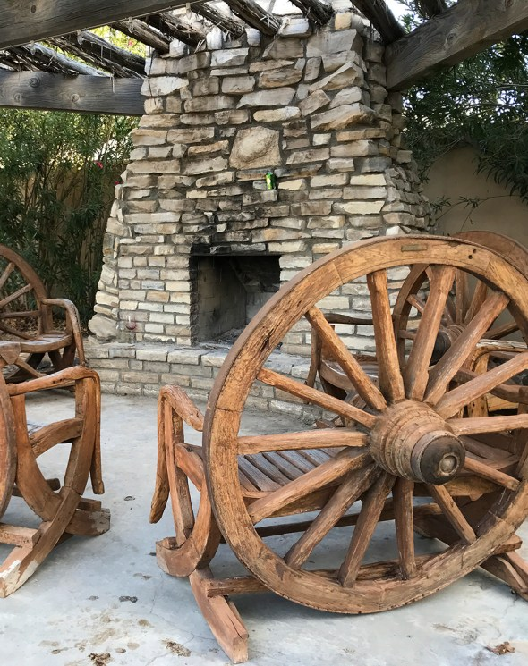 Wagon Wheel Chairs and Outdoor Fireplace