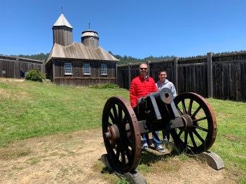 Brian and Carter Standing By A Cannon
