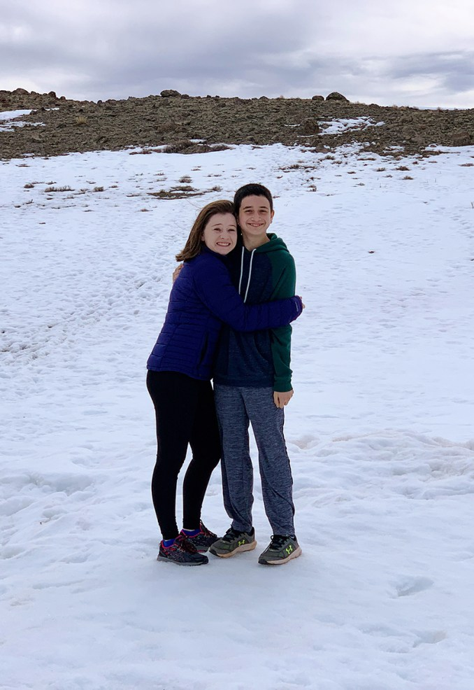 Natalie and Carter Standing In The Snow at the Utah 12 Homestead Overlook
