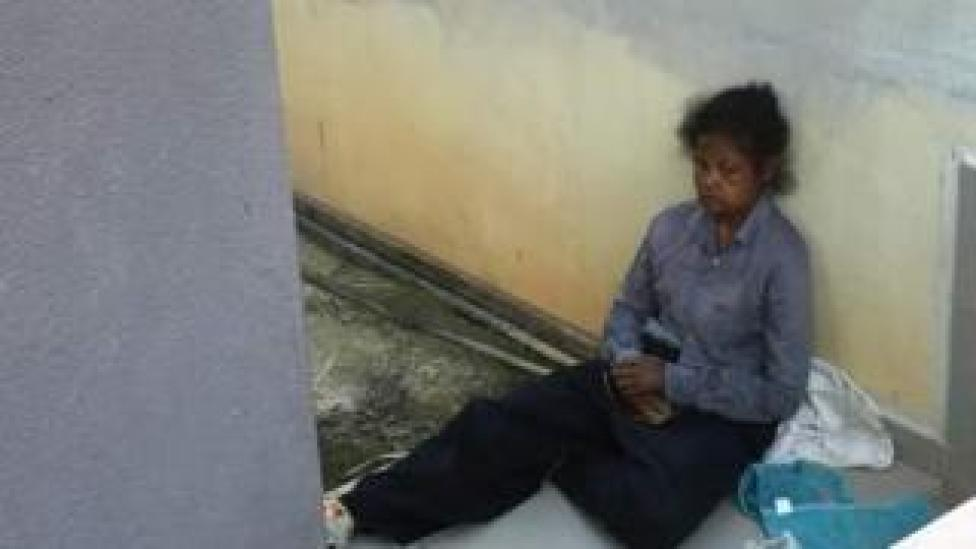 Adelina sat outside her employer's home in Malaysia