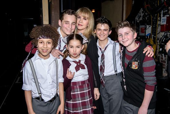 "NEW YORK, NY - APRIL 26: Stevie Nicks (C) of the band Fleetwood Mac poses for a photo backstage with cast members of ""School of Rock - The Musical"" at the Winter Garden Theatre on April 26, 2016 in New York City. (Photo by Matthew Eisman/Getty Images for School of Rock - The Musical)"