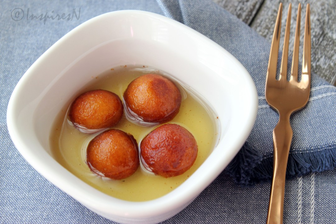 gulab jamun with saffron and cardamom flavored syrup
