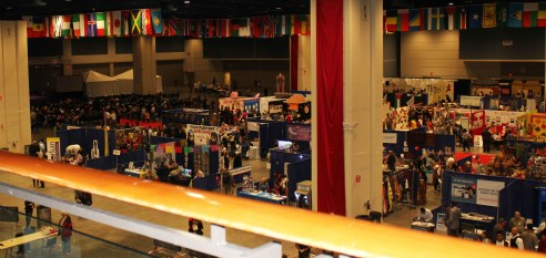 The view from the upper level shows the organized booths and stages