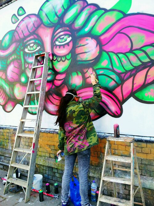 Swedish artist Amara Por Dios in action on Great Eastern Street
