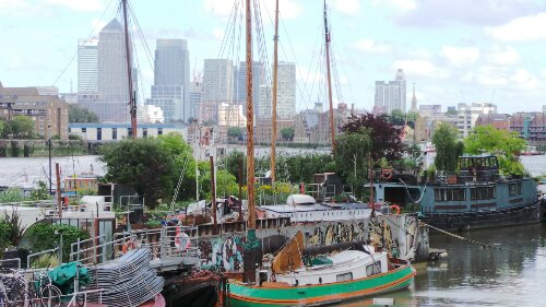 The barge with the towers of Canary Wharf in the background