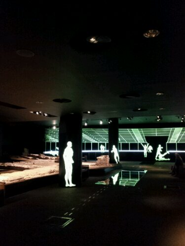 The futuristic re-interpretation of people participating in the sort of activities within the ampi-theatre has been created.