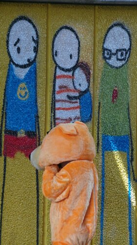 This orange bear checks out the new look mural