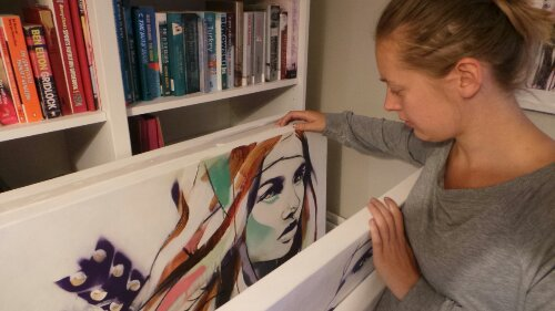 Hannah looking through some of the canvases for the show