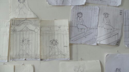 Pencil sketches stuck up on the wall