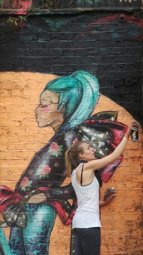 Lucy adds some final touches to her part of the mural