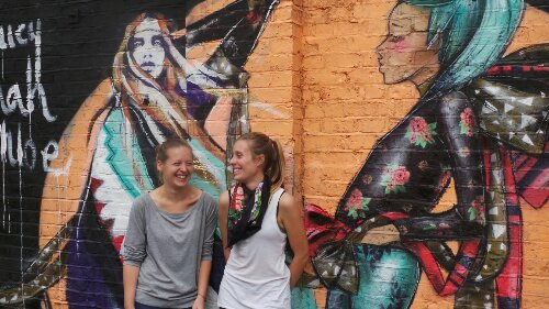 Hannah Adamaszek and Lucy Lucy by their finished mural in Dalston