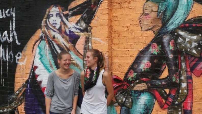 Hannah Adamaszek and Lucy Desbordes by their finished mural in London