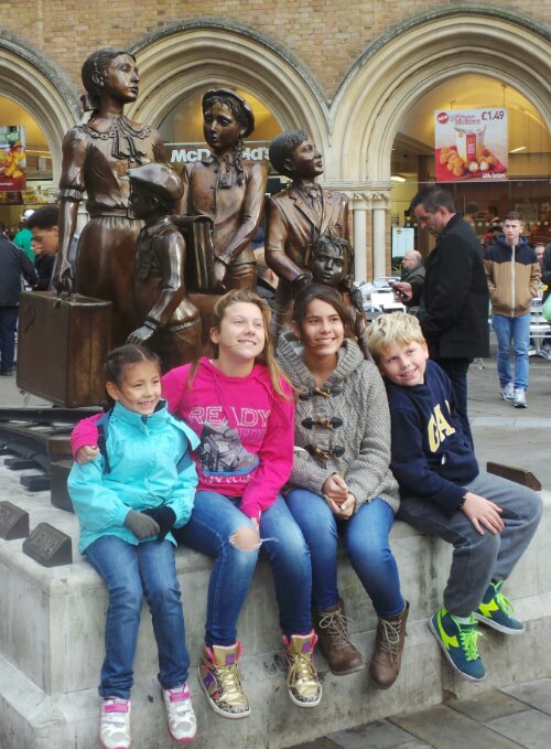 Children pose by the Kindertransport statue.  This is where we start our tour