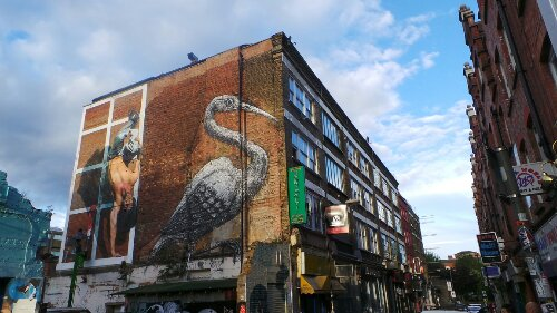 Martins hand standing Queens Guard next to ROA's famous Crane on Hanbury Street