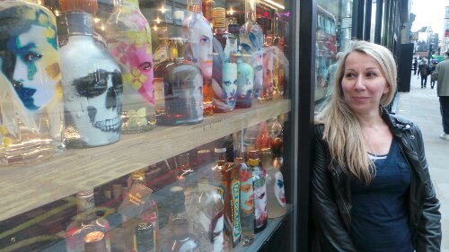 "Yvonne Wayling admires her bottles in the window ""it's been a rewarding experience"" she told me"