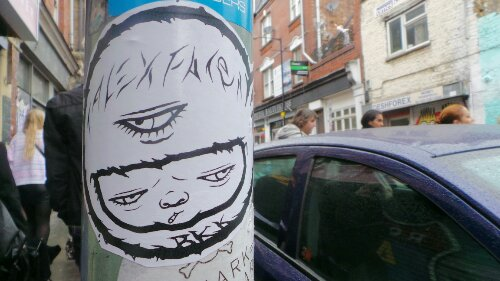Alex Face's signature style, a baby with three eyes