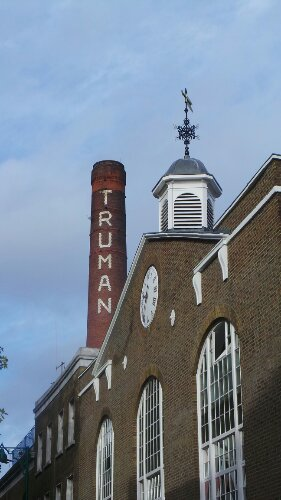 The clock house and the giant chimney of the Truman Brewery