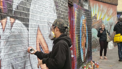 Alex in action, painting the wall