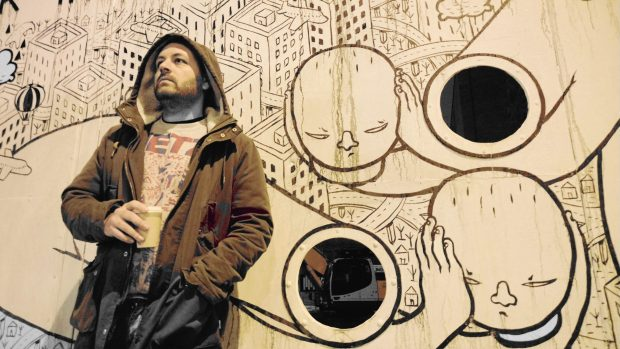 Millo by a piece of street art on Old Street near to the Hoxton Gallery