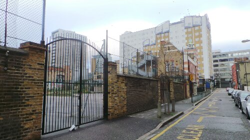 Henriques Street looking north toward Commercial Road.  Dutfield's Yard would have been to the back of the photo in the schoolyard