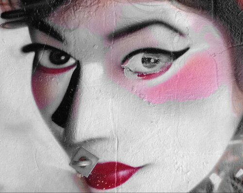 A close up of one of the Geisha girls in Kobra's mural