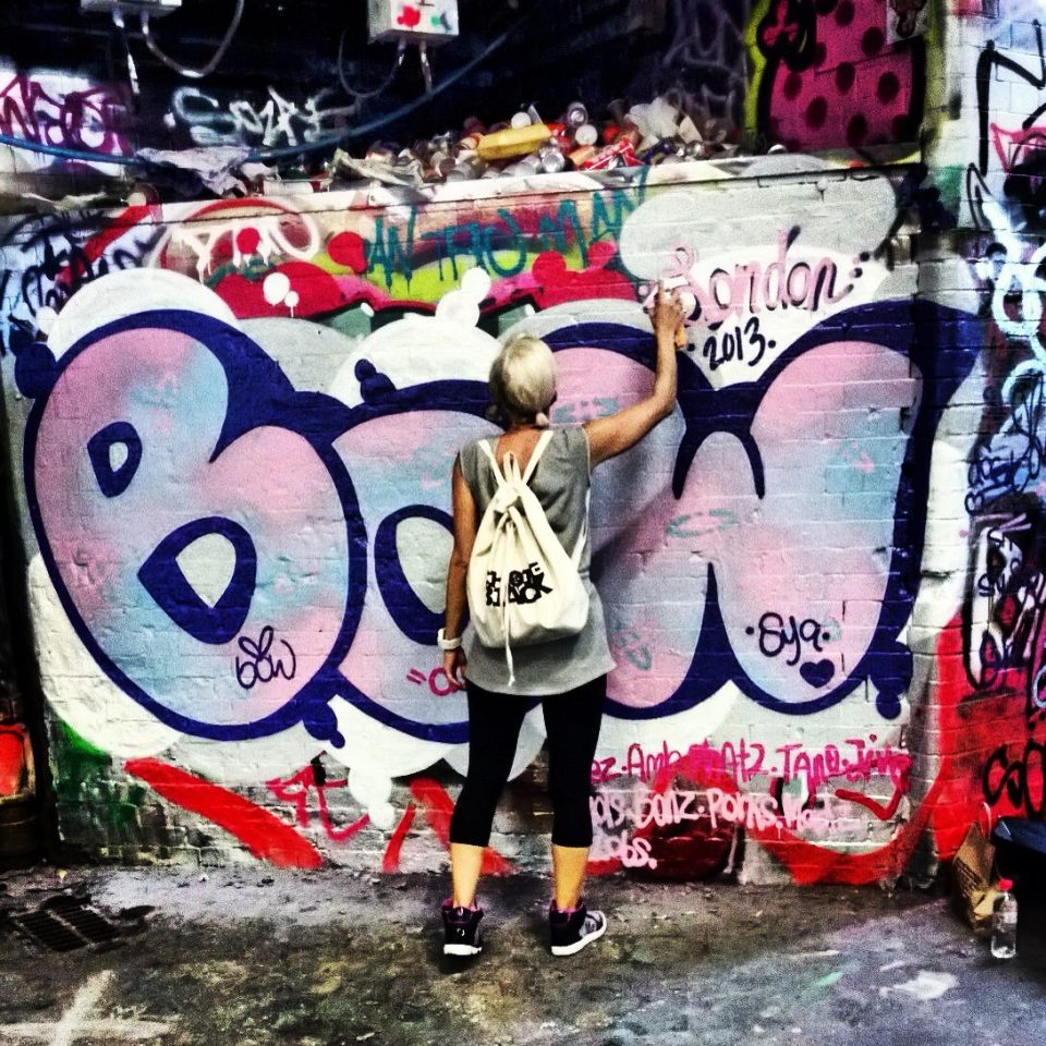 Painting Bows on Leake Street.  Picture by Steffi Bow