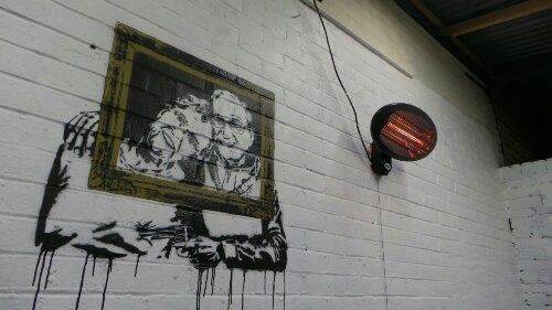 At the back of the gallery Aito has painted this and a number of other pieces on the walls