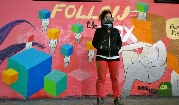 Boxhead next to her work in the tunnel