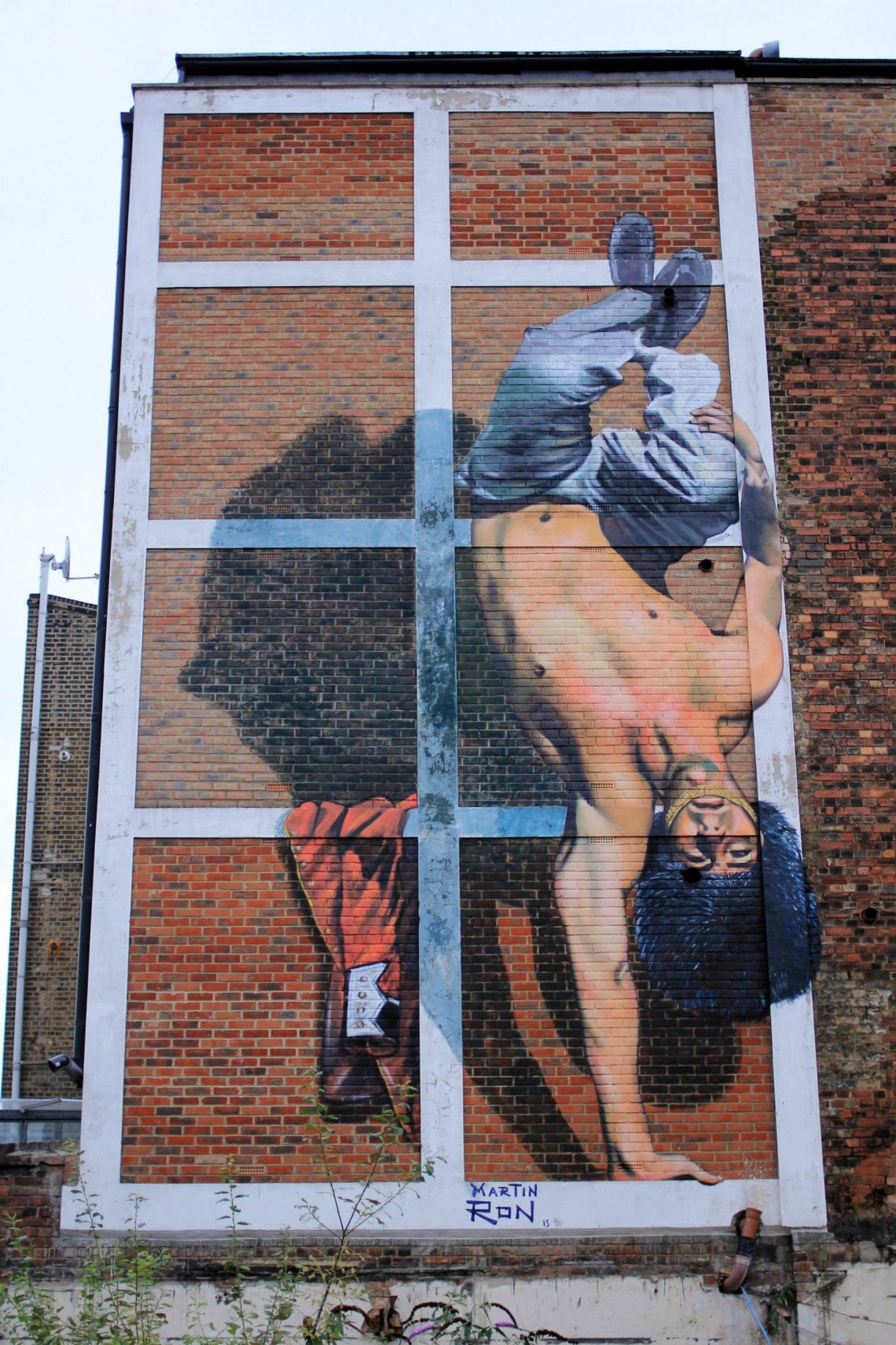 Happy Hour Mural depicting a Queens Guard doing the Capoeira in London. The mural is by Martin Ron