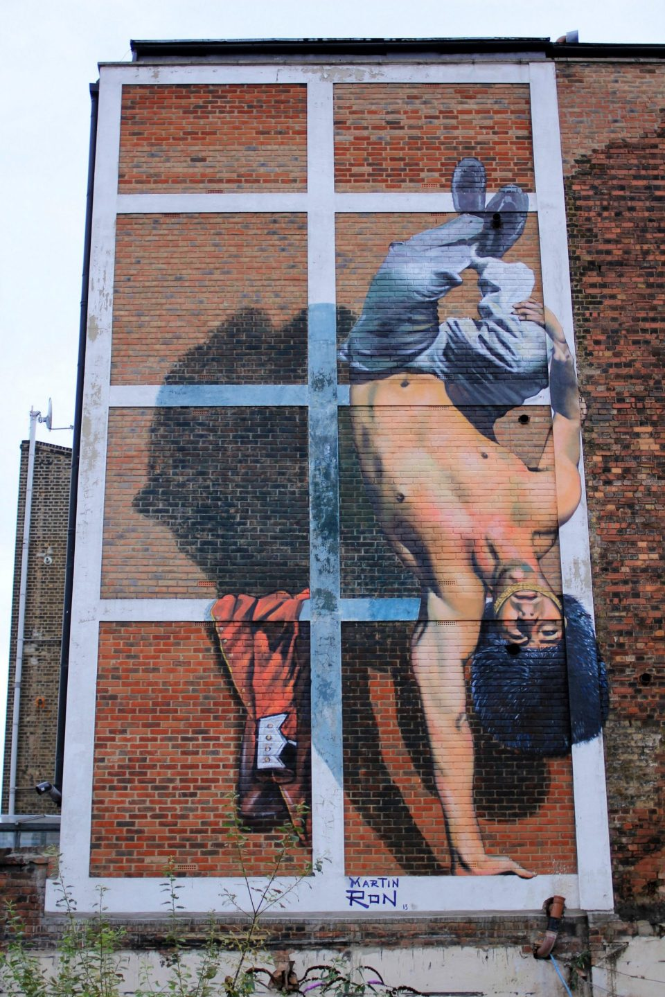 Happy Hour Mural depicting a Queens Guard doing the Capoeira in London