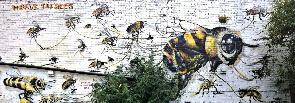An epic bee mural on Hackney Road from the pallettes of Masai and Vision