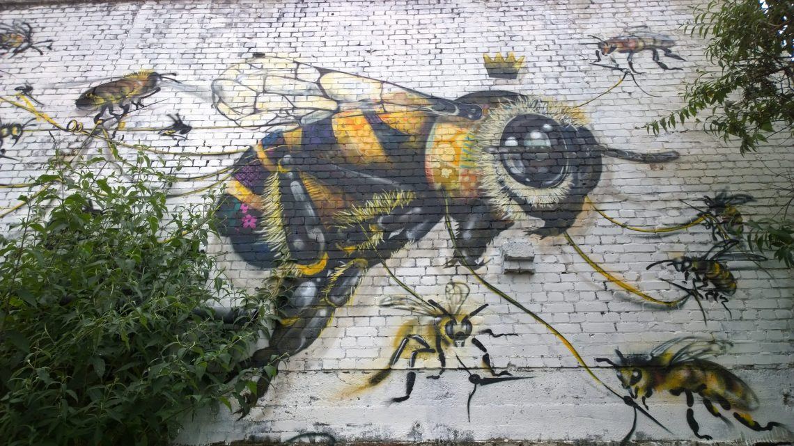 The mural features a huge which appears to be sewn together by the other little bees
