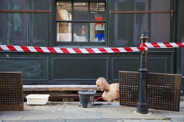 A workman potters around on Fournier Street