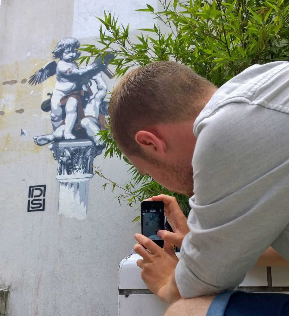 Roys People photographs one of his little guys next to a new piece by DS Art