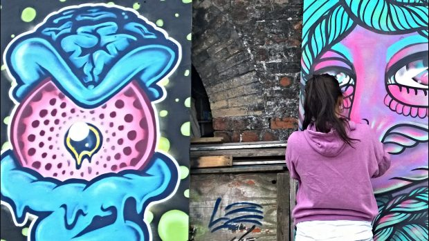 Amara Por Dios finishing off her piece next to completed work from The Real Dill