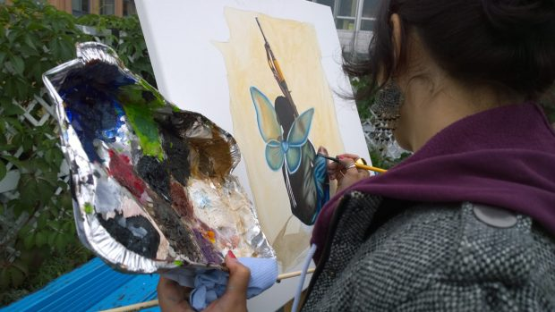Andrea Tyrimos adding detail to her painting