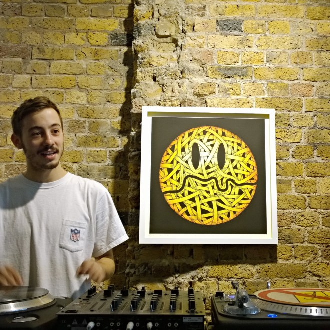 Ryan Holmes at the gallery mixing desk with work from Otto Schade