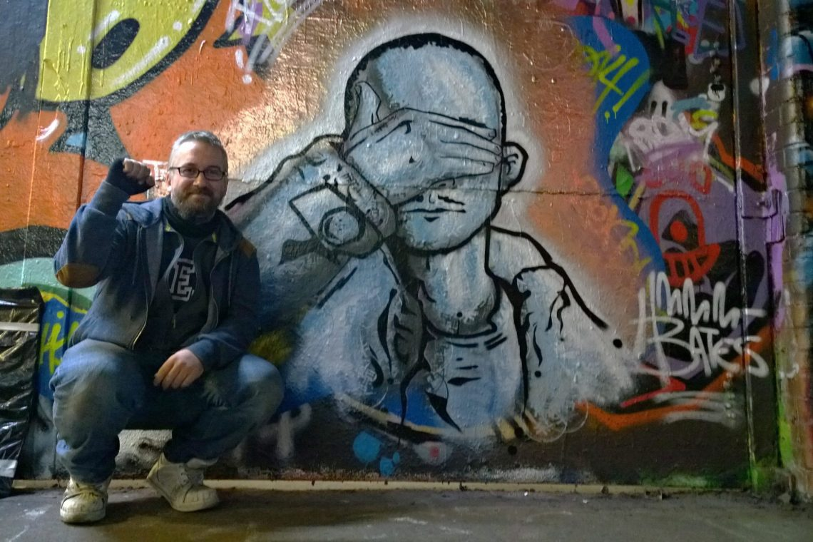 Pauli Bates next to his tribute piece to Ben Naz in the Leake Street tunnel
